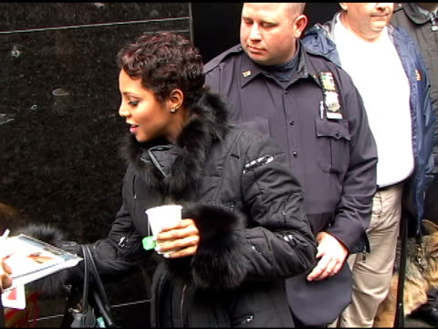 toni braxton signs some autographs as she departs 'good morning america' in new york 04/05/11 - autogramm stock-videos und b-roll-filmmaterial
