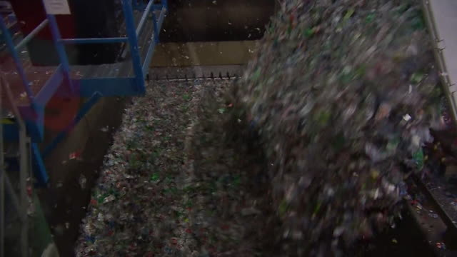 tonnes of plastic waste being poured into a tip - environmental damage stock videos & royalty-free footage