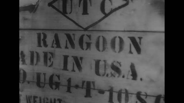 """tons of american manufactured materiel on a dock including oil drums, tires, powder kegs, crate with stencil: """"rangoon, made in usa"""" / temple with... - stencil stock videos & royalty-free footage"""