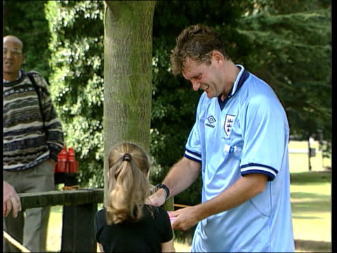 tony adams book lib hoddle signing autograph for young girl glenn hoddle interviewed theres only one thing 100 percent in mind my and thats sweden on... - book signing stock videos & royalty-free footage