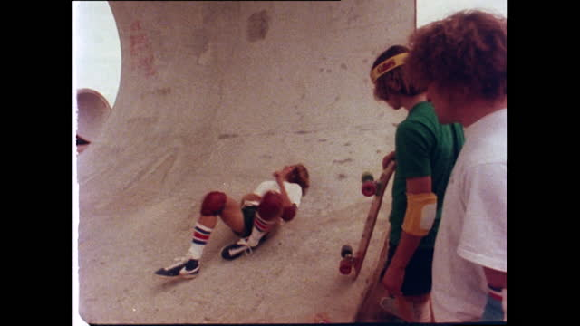 tony alva, a professional skateboarder, falls from his skateboard in a concrete pipe and injures his ankle; 1978. - young men stock videos & royalty-free footage
