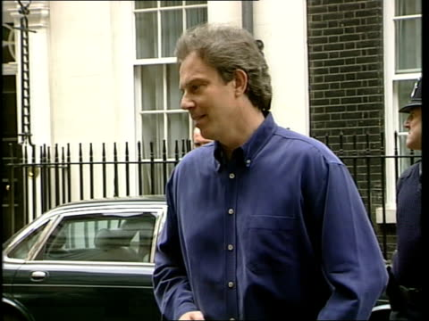 Baby Leo born DAY Prime Minister Tony Blair MP from number 10 dressed casually and holding mug PAN as across to mikes Blair at mikes Prime Minister...