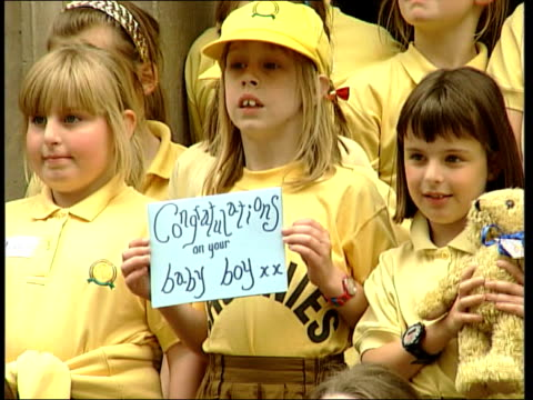 tony and cherie blair: baby leo born; england: london: downing street: ext brownies standing and kneeling before door of number 10 holding up paper... - teddy boy stock videos & royalty-free footage