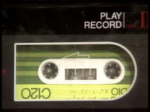 vídeos de stock, filmes e b-roll de tony benn archive cms cassette in tape deck tcms 8mm cineprojector as reel loaded - tony benn