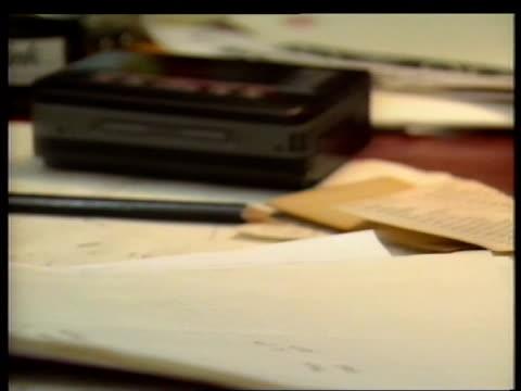 stockvideo's en b-roll-footage met tony benn archive; england: london: holland park cms side tony benn mp turns away from shelf full of papers & to desk tcs hand picks up dictating... - tony benn