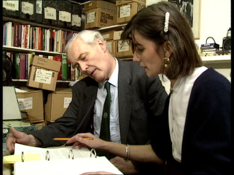 vídeos de stock, filmes e b-roll de archives 11 tony benn seated with personal secretary discussing the oil events of 1979 and a meeting with micheal brunson of itn benn places audio... - tony benn