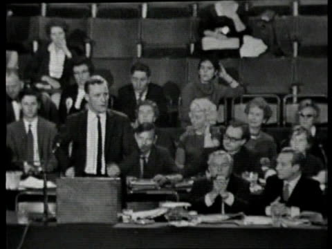 stockvideo's en b-roll-footage met tony benn diaries; itn lib benn speech at mike at conference wilson seated wilson smoking pipe and pats hair in place - tony benn