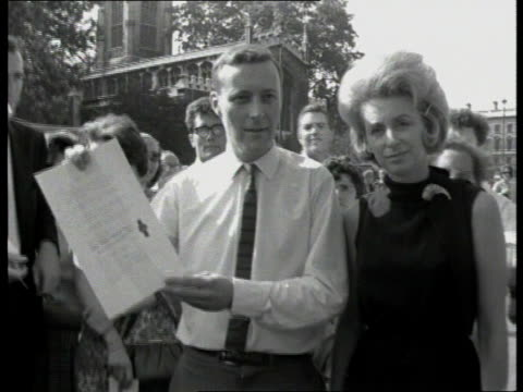 tony benn diaries; itn lib england: westminster cms tony benn posing with wife holding up document document with seal itn lib bristol benn wearing... - トニー ベン点の映像素材/bロール