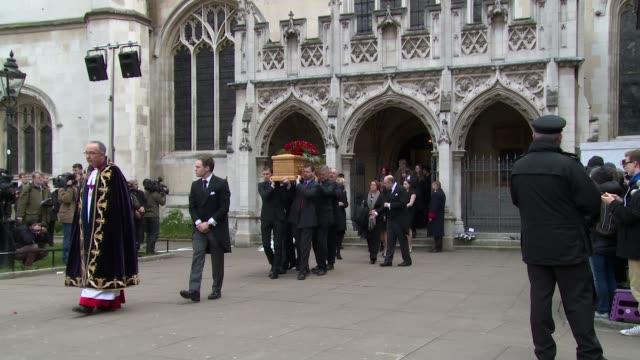 tony benn's coffin leaves the church at tony benn - funeral at st margaret's church on march 27, 2014 in london, england. - トニー ベン点の映像素材/bロール