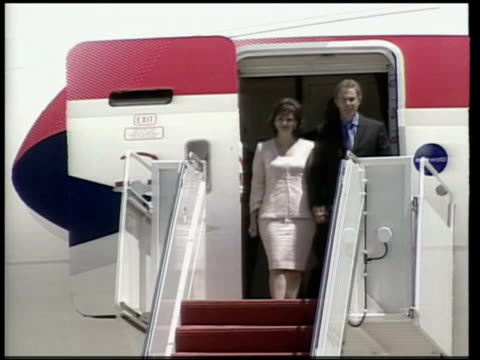 tony blair addresses us congress pool washington tony blair mp and wife cherie blair down steps of plane la fountains in park with capitol building... - down jacket stock videos and b-roll footage