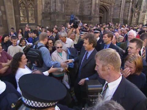 tony blair and donald dewar greet crowds on the royal mile in edinburgh during a proscottish devolution campaign - royal mile stock videos and b-roll footage