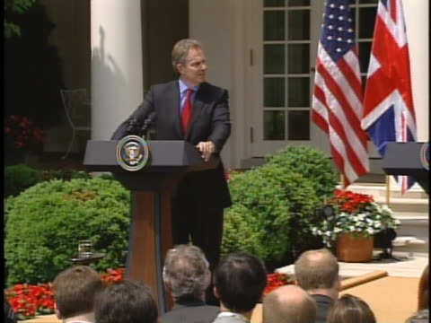 tony blair and george w. bush hold a joint press conference in the white house rose garden in washington d.c. - american politics stock videos & royalty-free footage