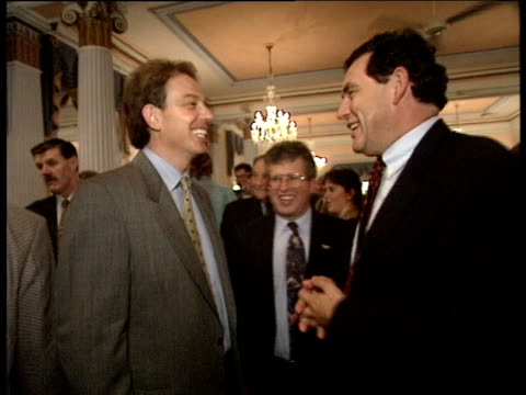 tony blair and gordon brown shake hands laugh and smile happily at each other following labour party conference brighton oct 95 - ゴードン ブラウン点の映像素材/bロール