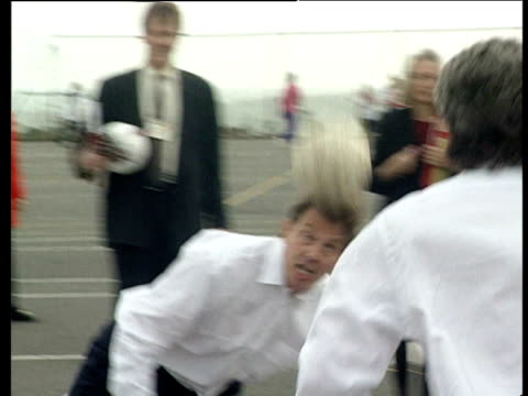 tony blair and kevin keegan head football to each other during leisure centre visit brighton 02 oct 95 - tony blair stock-videos und b-roll-filmmaterial