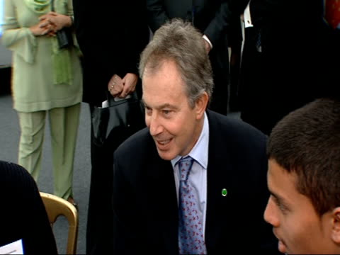 Tony Blair and Prince Andrew visit NSPCC 'Full Stop' campaign event GOOD SHOT of Cilla Black smiling and talking with a glass of white wine in her...