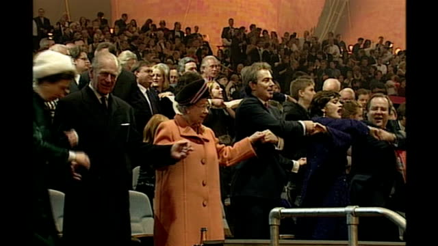 blair's britain lib greenwich millennium dome blair holding hands with his wife cherie and with queen elizabeth ii as 'auld lang syne' is sung sot - dome stock videos & royalty-free footage