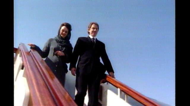 stockvideo's en b-roll-footage met tony blair announces resignation: blair's britain; tx 18.4.1998 saudi arabia: jeddah: ext blair and wife cherie down plane steps during middle east... - jiddah