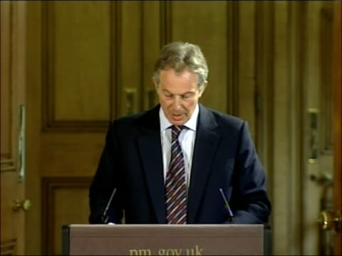 tony blair april 2007 monthly press briefing england london downing street int tony blair mp out to podium **flash photography** / tony blair press... - comforting colleague stock videos & royalty-free footage