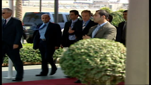 tony blair arrives in beirut ext blair with siniora surrounded by officials walking along from building / blair along then into car / close up of... - lebanese flag stock videos and b-roll footage