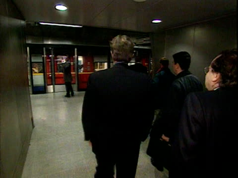 Tony Blair boards a train on the London Underground