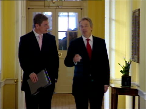 tony blair comments on possible un sanctions; england: london: 10 downing street: int tony blair mp along corridor with hungarian prime minister... - ungarische kultur stock-videos und b-roll-filmmaterial