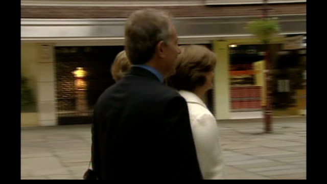 tony blair converts to catholicism r24090601 ext tony and cherie blair arriving for church service prior to party conference - katholizismus stock-videos und b-roll-filmmaterial