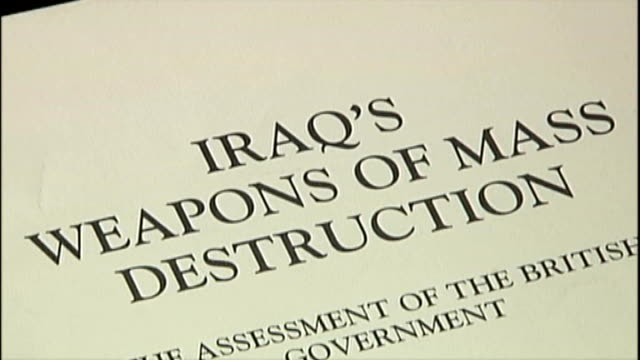 tony blair criticises media tx close shot front page of 'iraq's weapons of mass destruction' assessment document - weapons of mass destruction stock videos & royalty-free footage