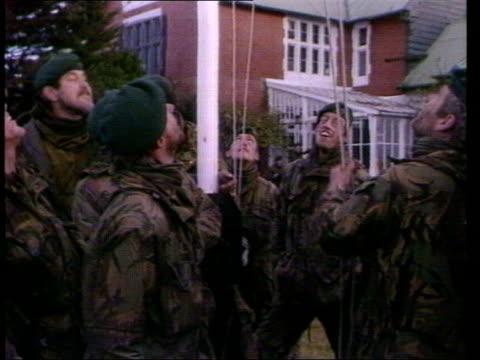 vídeos de stock e filmes b-roll de tony blair denies iraq accusations itn lib from server island port stanley british soldiers raising union jack flag after taking the islands england... - ilhas malvinas