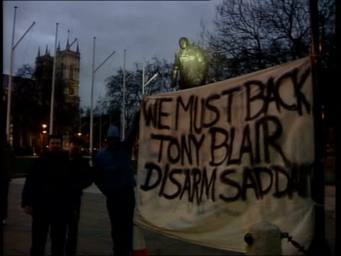 tony blair diplomacy; itn ext 'we must back tony blair: disarm saddam' banner held up by pro-war protestors zoom in winston churchill statue - diplomacy stock videos & royalty-free footage