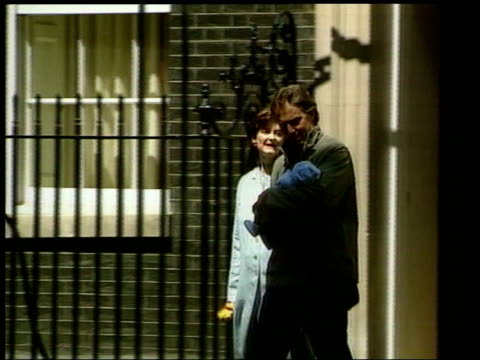 london downing street ms tony blair towards from door of no10 holding baby son leo blair with wife cherie blair zoom in as along to car - babies in a row stock videos & royalty-free footage