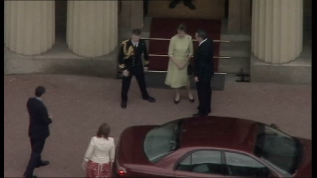 tony blair handover of power to gordon brown; buckingham palace: air view brown and macauley out of red vauxhall car as greet officials prime... - on air sign stock videos & royalty-free footage