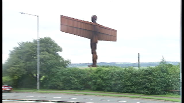 tony blair handover of power to gordon brown * * music overlaid on the following shots sot * * glass driving car along past antony gormley sculpture... - angel of the north stock videos and b-roll footage
