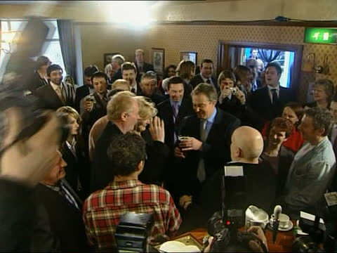 tony blair meets 'coronation street' cast; england: manchester: int tgv prime minister tony blair along to meet people in 'rovers return' and posing... - soap opera stock videos & royalty-free footage