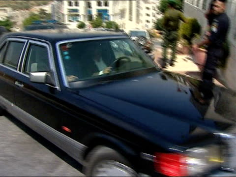 tony blair meets shimon peres during visit as international envoy israel west bank ramallah ext car carrying tony blair along through gates blair out... - ramallah stock videos and b-roll footage