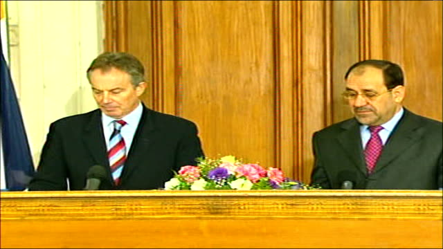 tony blair press conference with iraqi prime minister nouri almaliki man speaking in arabic as blair and nouri almaliki stand behind podium - iraqi prime minister stock videos & royalty-free footage