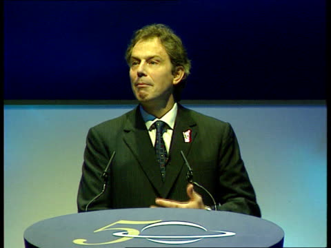 tony blair promises more investment itn london earls court int tony blair mp along stage to podium with nhs all our tomorrows 50 backdrop ls blair on... - earls court stock videos & royalty-free footage