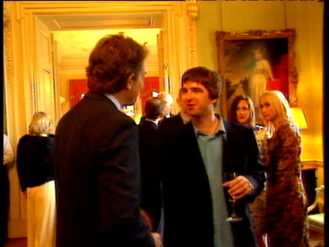 tony blair shakes hands with and talks to noel gallagher during no10 downing street reception party 03 sep 97 - political party stock videos & royalty-free footage
