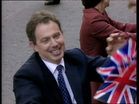 Tony Blair shakes hands with crowds on day he became Prime Minister 02 May 97