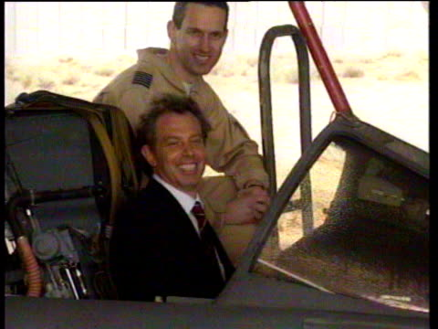tony blair smiles and points to camera whilst sitting inside cockpit of tornado airplane with raf pilot kuwait 09 jan 99 - トニー ブレア点の映像素材/bロール