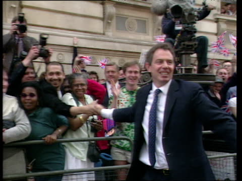 Tony Blair smiles waves and shakes hands with crowds on day he became Prime Minister 02 May 97