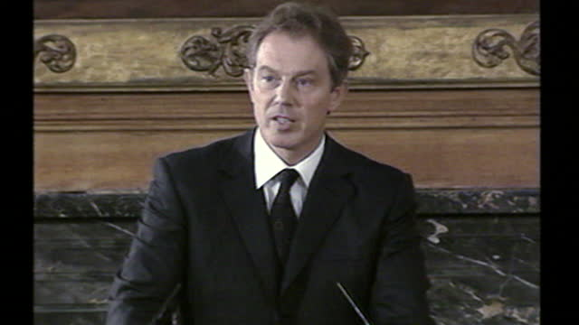 tony blair speaks at a press conference condemns the 9/11 attacks, fears british casualties and asserts that they were in contradiction with the... - waist up stock videos & royalty-free footage