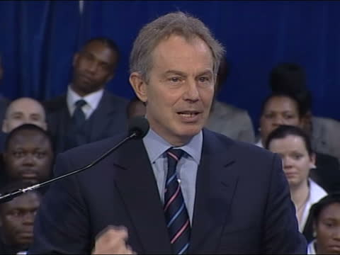 tony blair speaks at power of one event with community leaders in brixton; england: london: brixton: int tony blair mp speech sot - political parties... - innocence stock videos & royalty-free footage