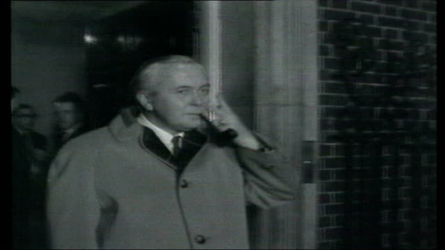 speculation over future lib w footage harold wilson waving from doorway of no 10 downing street with pipe in his mouth - harold wilson stock-videos und b-roll-filmmaterial