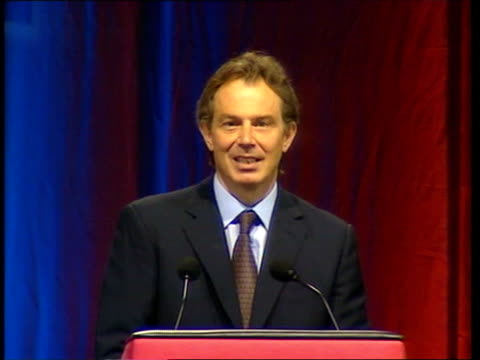 tony blair speech to women's institute; itn england: london: wembley arena: int tony blair mp along onto stage next woman at women's institute... - wembley arena stock videos & royalty-free footage