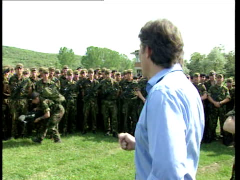 Tony Blair stands before British troops and talks of purpose of their presence being to help prevent ethnic cleansing and racial genocide in Kosovo...