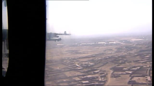 helmand province view of countryside seen from open door of helicopter as flying over helmand province on arrival at temporary british base camp... - apache helicopter stock videos and b-roll footage