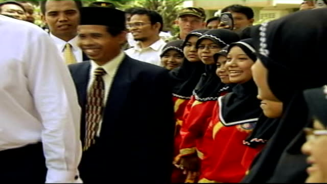 stockvideo's en b-roll-footage met jakarta ext tony blair mp watching school band perform during visit to islamic boarding school group of pupils wearing white headscarves playing... - menselijke arm