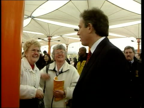 Tony Blair visit ITN ENGLAND London Greenwich Millennium Dome CBV Tony Blair shaking hands with two visitors LA MS Blair PierreYves Gerbeau and...