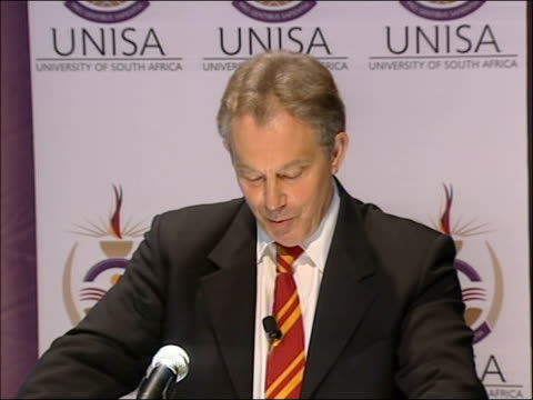 tony blair visit: speech at university of south africa business school; blair along to podium / tony blair mp speech sot - thank you very much for... - 10 seconds or greater stock-videos und b-roll-filmmaterial