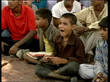 tony blair visit to discuss trade and terrorism; india: new delhi: ext gv orphaned street children acting out scene about aids as other children... - no doubt stock-videos und b-roll-filmmaterial